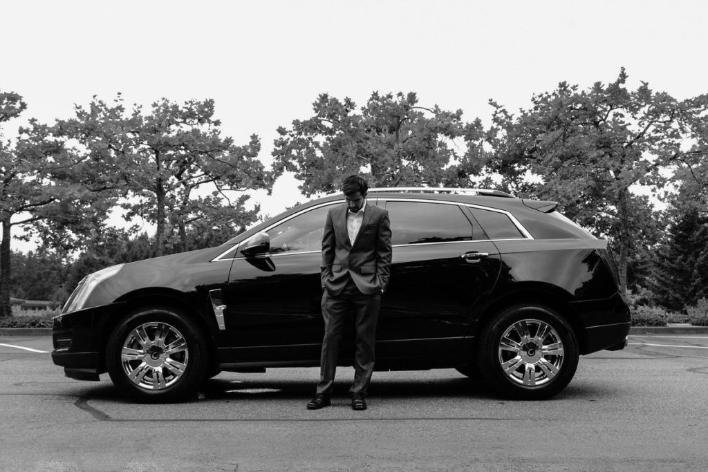 Business man with Cadillac
